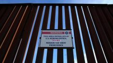 A Donald Trump for President campaign sticker is shown attached to a U.S. Customs sign hanging on the border fence between Mexico and the United States near Calexico, California, U.S. February 8, 2017. Picture taken February 8, 2017. REUTERS/Mike Blake
