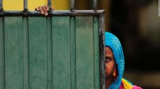 A Sri Lankan Muslim woman looks out on the street, in Aluthgama, town, 50 kilometers (31.25 miles) south of Colombo, Sri Lanka, Monday, June 16, 2014. At least three Muslims were killed after a right-wing Buddhist group with alleged state backing clashed with Muslims in southwestern Sri Lanka, a government minister said Monday. Dozens of shops were burned, homes looted and some mosques attacked in the violence Sunday night in the town of Aluthgama, local residents said. (AP Photo/Eranga Jayawardena)