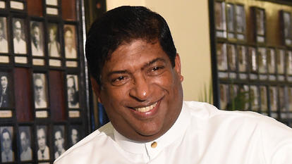 Sri Lankan Finance Minister Ravi Karunanayake arrives at parliament to present a supplementary budget to parliament, marking the second economic policy statement of the new government which came to power earlier in the month, in Colombo on November 10, 2016. / AFP / ISHARA S.KODIKARA        (Photo credit should read ISHARA S.KODIKARA/AFP/Getty Images)