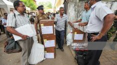 COLOMBO, SRI LANKA - AUGUST 16 : Sri Lankan election staff transport ballot boxes to polling stations for the upcoming parliamentary election on August 16, 2015 in Colombo, Sri Lanka. Sri Lanka goes to the polls on 17th August 2015. (Photo by Chamila Karunarathne/Anadolu Agency/Getty Images)