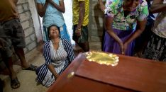 Mandatory Credit: Photo by Gemunu Amarasinghe/AP/REX/Shutterstock (10215983f) Relatives cry near the coffin with the remains of 12-year Sneha Savindi, who was a victim of Easter Sunday bombing at St. Sebastian Church, after it returned home, in Negombo, Sri Lanka. Easter Sunday bombings of churches, luxury hotels and other sites was Sri Lanka's deadliest violence since a devastating civil war in the South Asian island nation ended a decade ago Church Blasts, Negombo, Sri Lanka - 22 Apr 2019