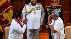 Sri Lanka's former president Mahinda Rajapaksa (L) gestures after taking oath as country's Prime Minister towards his brother, President Gotabaya Rajapaksa (R) during a ceremony in Colombo on November 21, 2019. - Newly elected Sri Lankan President Gotabaya Rajapaksa on November 20 named his brother Mahinda as Prime Minister, cementing the grip on power of a clan credited with brutally crushing the Tamil Tigers a decade ago. (Photo by LAKRUWAN WANNIARACHCHI / AFP) (Photo by LAKRUWAN WANNIARACHCHI/AFP via Getty Images)